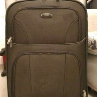 Two dark green luggage for sale