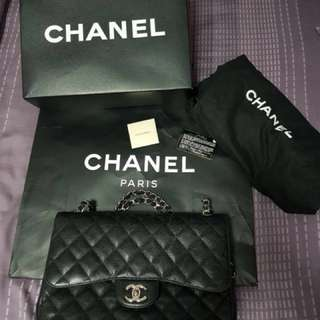 Authentic Chanel Black Quilted Caviar Jumbo Classic