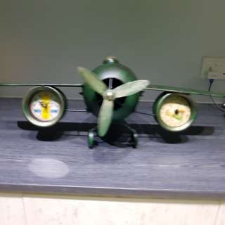 Vintage Army plane with clock