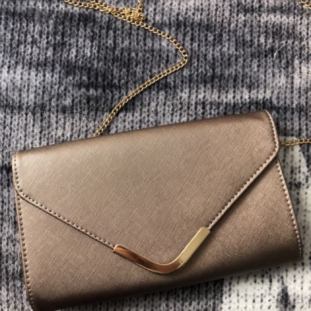 Charlotte Rousse rose gold clutch