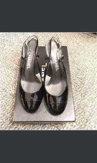 Chanel black patent leather slingback pumps