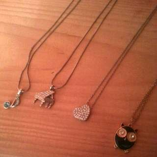 Four necklaces owl, piano, music note, and heart