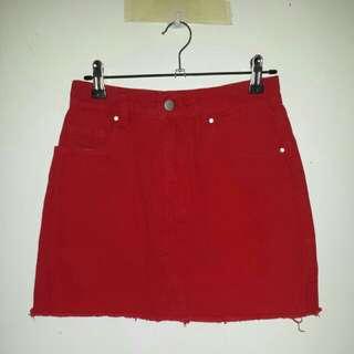 Red denim skirt.