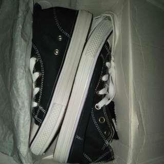 High cut black shoes