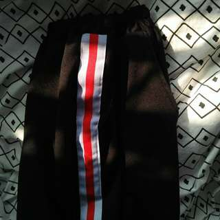 black track pants w red & white side strip