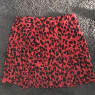 Red leopard print skirt with drill detail