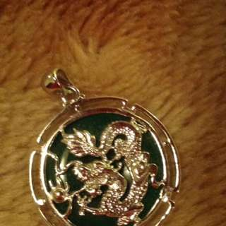 Silver dragon designed pendant on real jade