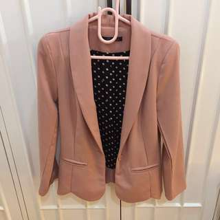 Pink blazer with polka dot lining