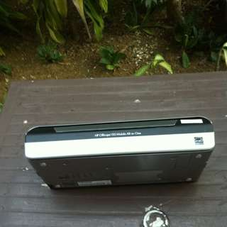 HP Officejet 150 mobile all-in-one printer with power cable and manual.