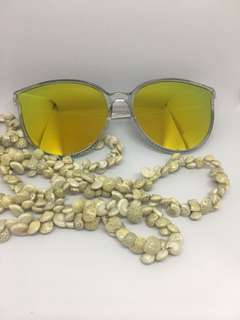 Yellow gold reflective lens sunglasses