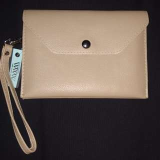 Nude wallet with strap