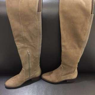 Sepatu boots winter musim dingin
