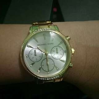Mk and gucci watches