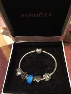 Pandora bracelet with 5 Pandora Charms in a box (with Certificate of Authenticity in Italian Language because it was bought in Italy)