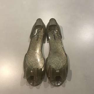 Call it spring- Gold jelly shoes flats