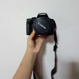 Canon 500D with lens