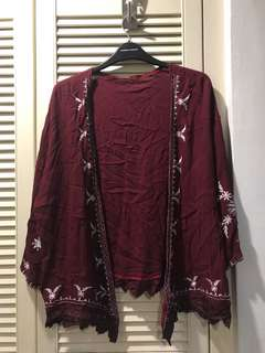 Red cardigan with prints