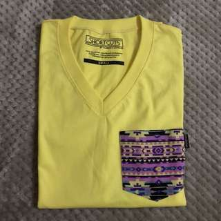 Yellow V-neck shirt with Aztec Design pocket
