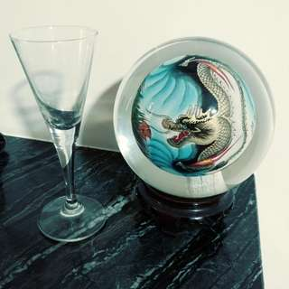 Antique crystal ball Dragon art painting With wooden base .
