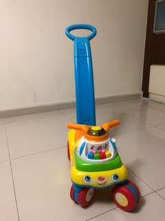 Fisher price ride on scooter with push up bar.