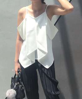 White cutted sleveless top