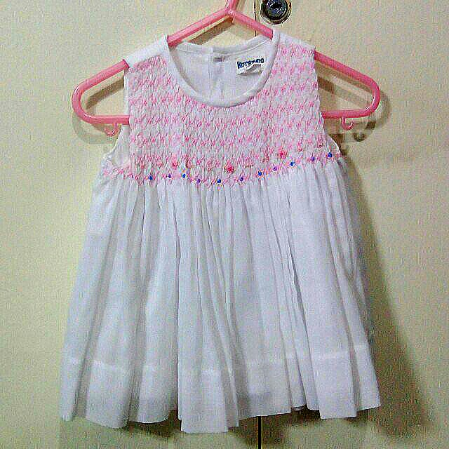 White smocked baby dress