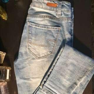 Light wash slightly distressed skinny jeans