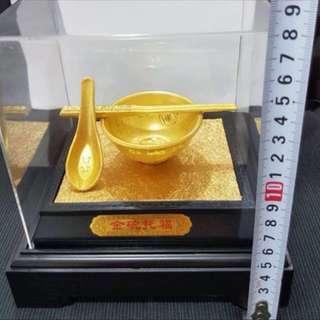 Gold plated rice bowl (金饭碗)