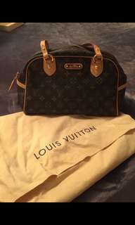 Authentic Louis Vuitton. Almost new.  Used couple of times.