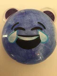 Laughing face emoji putty