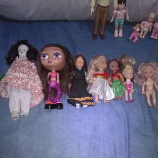 Assorted small old dolls