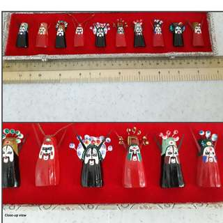 Chinese themed ornaments (opera masks and Chinese monk)