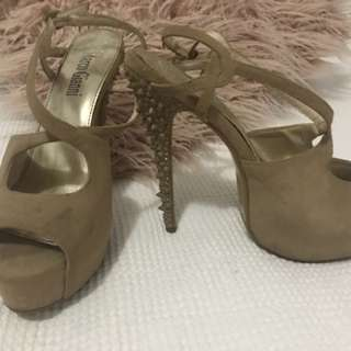 Nude strappy heels with spiked heel