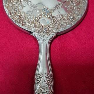 Vintage Hand mirror. antique but still usable. Made of heavy metal materials