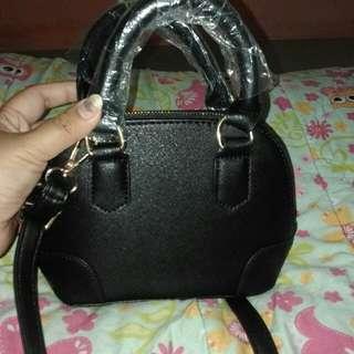 Mini black sling bag