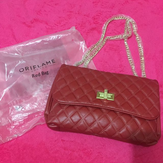ORIFLAME RED CLUTCH