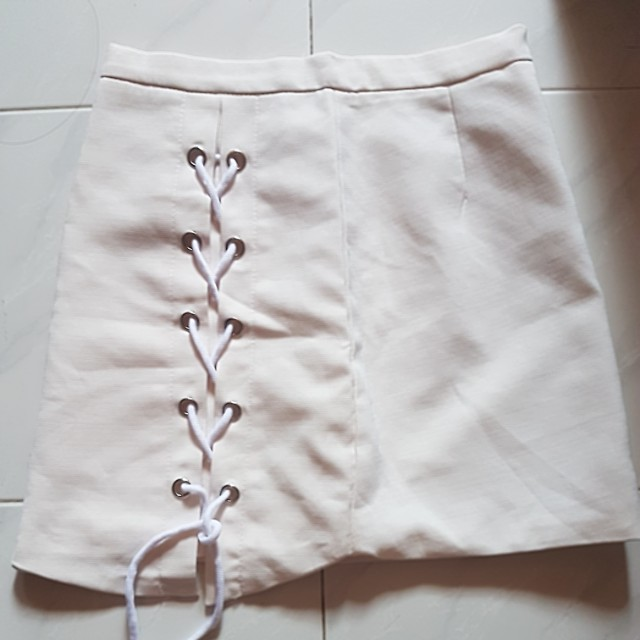 slight pinkish white skirt