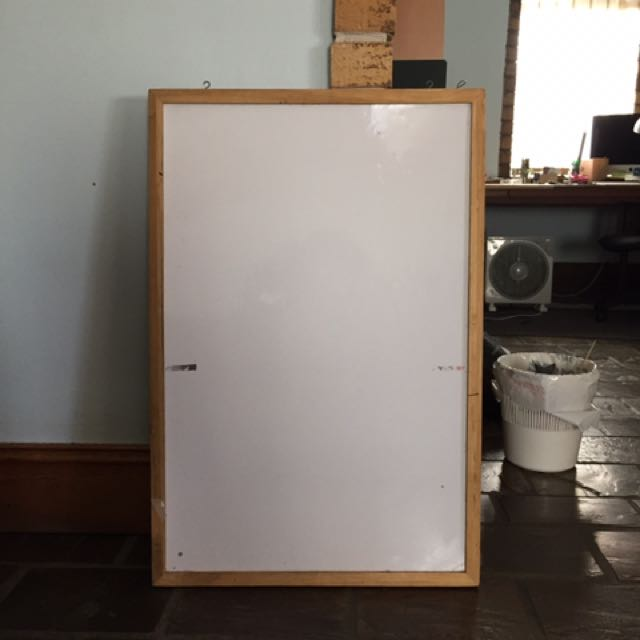 Whiteboard with timber frame and hooks