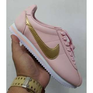 Nike Cortez pink and triple white