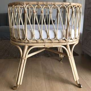 Near new cane bassinet