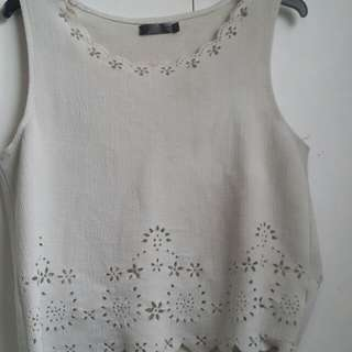 White crop top with flower like patterns