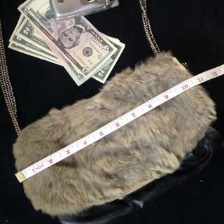 US BOUGHT FAUX FUR AND LEATHER CHAIN SLING $129USD