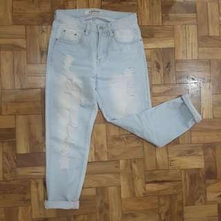 Faded ripped boyfriend jeans