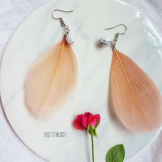 Handmade feather earrings with semiprecious beads