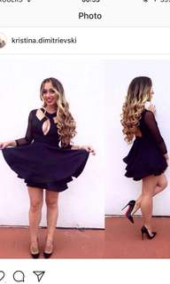 Black skater dress with structured skirt & mesh sleeves