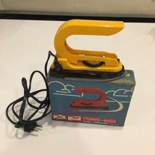 Vintage travel iron yellow