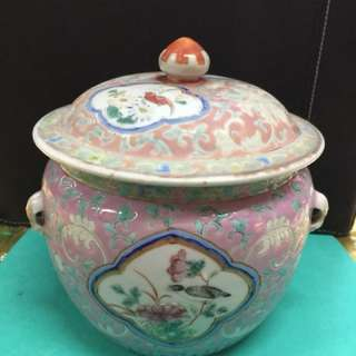 """Antique Nonya pink based family-rose jar with cover. Height including cover: 5 1/2""""; excluding cover 3 3/4"""". Diameter of jar's mouth: 4 1/2"""". About 140 years. Dynasty mark on bottom."""