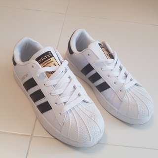 Used - inspired Adidas woman shoes size 38
