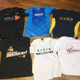 Assorted race and tournament shirts