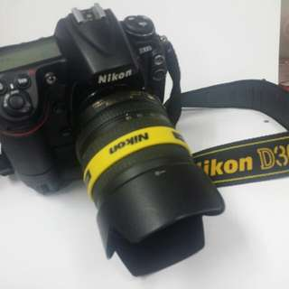 Nikon D300s body, Nikon lens 18-105 mm f/3.5-5.6 G ED VR & Nikon MB-D10 multi power battery pack.